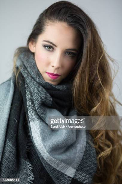 Beautiful woman in her twenties, long hazel hair with a scarf in blue and gray