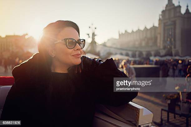 Beautiful woman in horse carriage