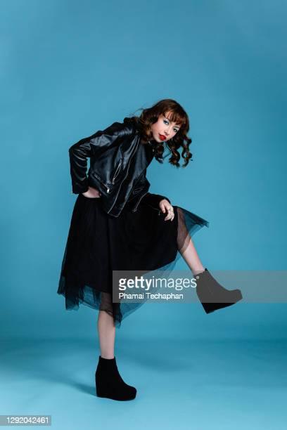 beautiful woman in leather jacket - schwarzes kleid stock-fotos und bilder