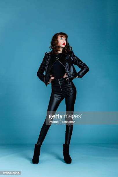 beautiful woman in leather jacket - leather stock pictures, royalty-free photos & images