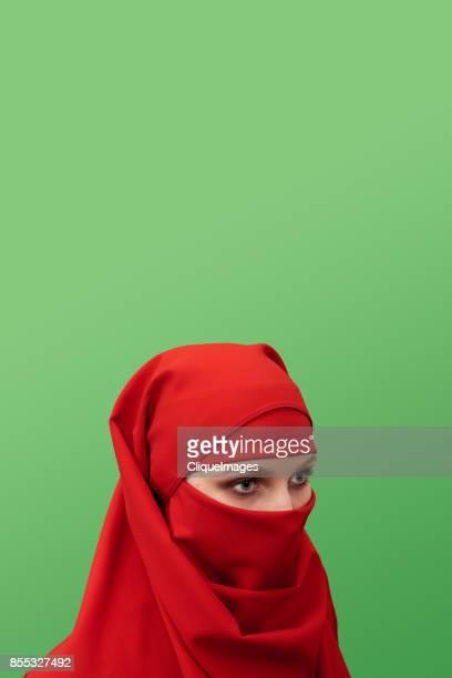 beautiful woman in niqab - cliqueimages ストックフォトと画像