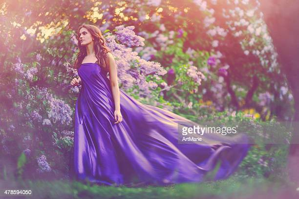 beautiful woman in park - purple dress stock pictures, royalty-free photos & images