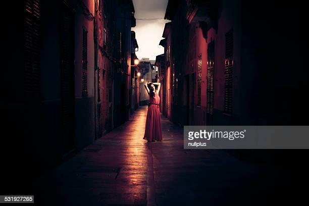 beautiful woman in red dress posing