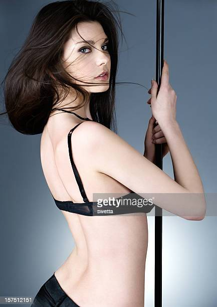 Beautiful woman in sexual bikini on pole