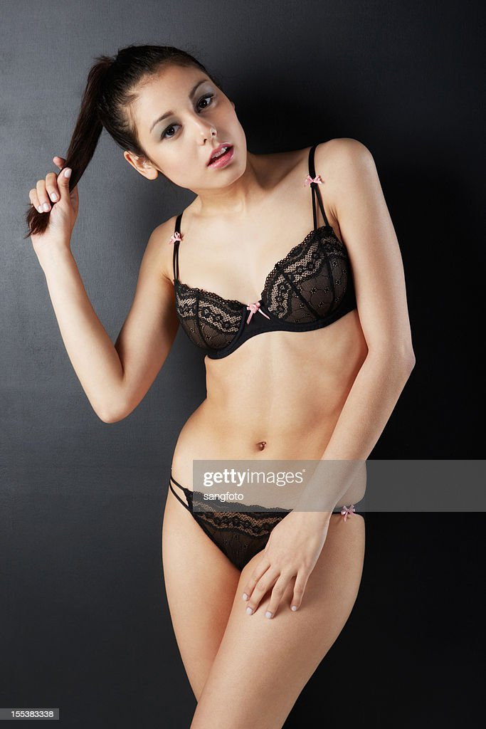 Beautiful Woman In Sexy Lingerie Holding Ponytail Stock ...