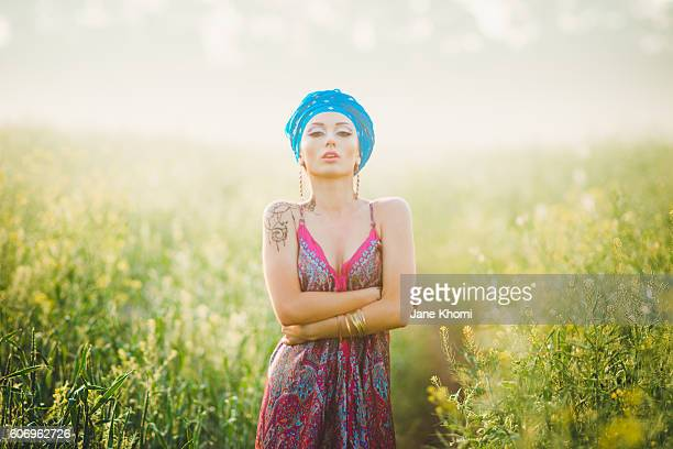 Beautiful woman in sunrise lights