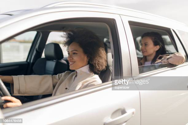 beautiful woman in the car - car pooling stock photos and pictures