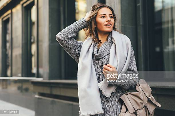 beautiful woman in the city - jumper stock pictures, royalty-free photos & images