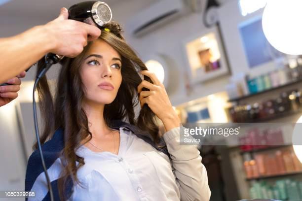 Beautiful woman in the hair salon