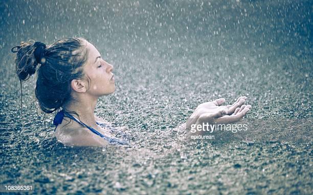 Beautiful woman in the rain
