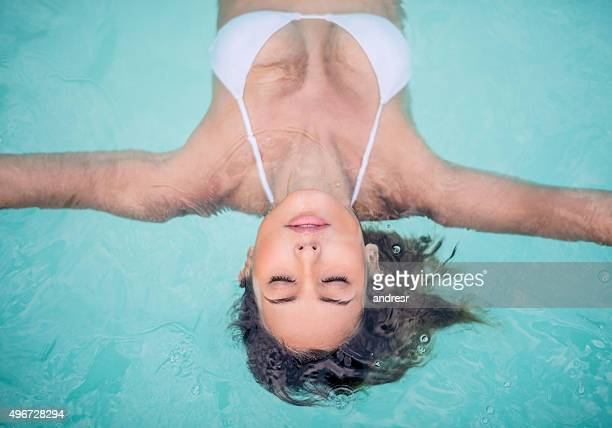 Beautiful woman in the swimming pool at the spa