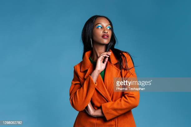 beautiful woman in trench coat - fashionable stock pictures, royalty-free photos & images