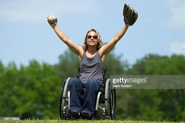 beautiful woman in wheelchair playing catch - paraplegic stock photos and pictures