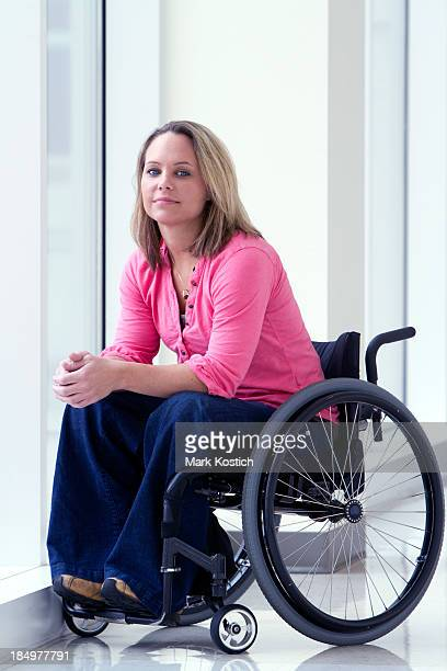 beautiful woman in wheelchair smiling - paraplegic stock photos and pictures