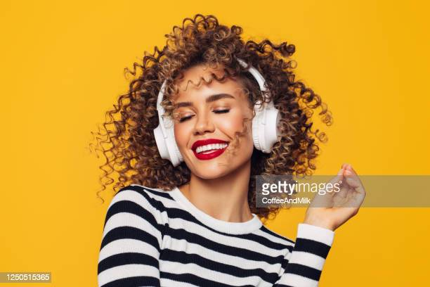 beautiful woman in white headphones listens to music - headphones stock pictures, royalty-free photos & images
