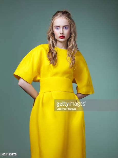 beautiful woman in yellow dress - fashion stock pictures, royalty-free photos & images