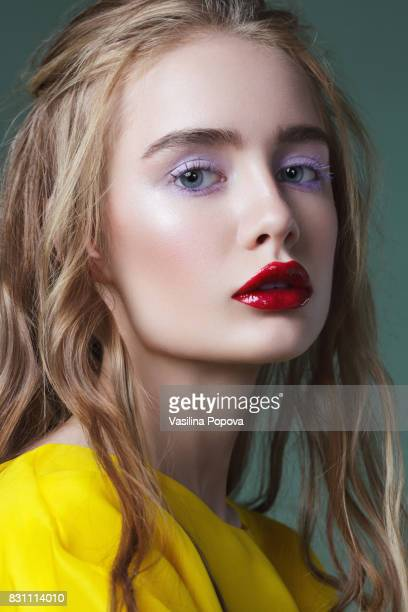 beautiful woman in yellow dress - purple eyeshadow stock photos and pictures