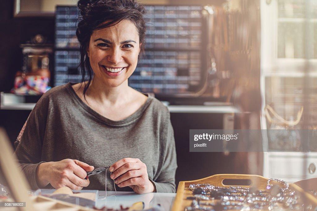 Beautiful woman jewelry maker : Stock Photo