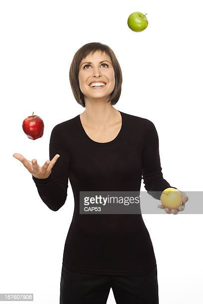 Beautiful woman Juggling With Three Apples