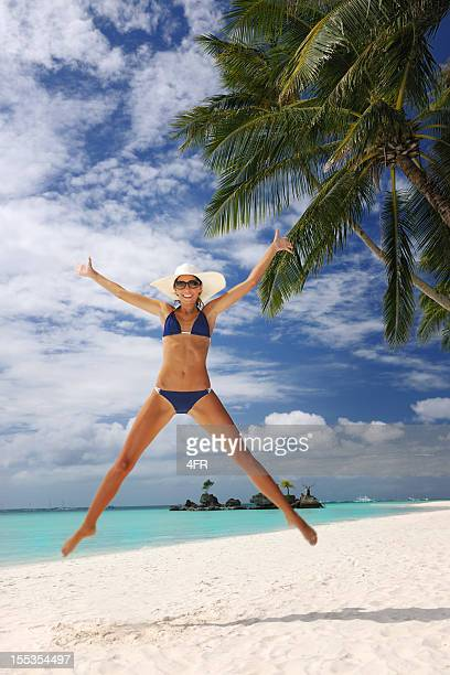 Beautiful Woman jumping on a White Sand Beach (XXXL)