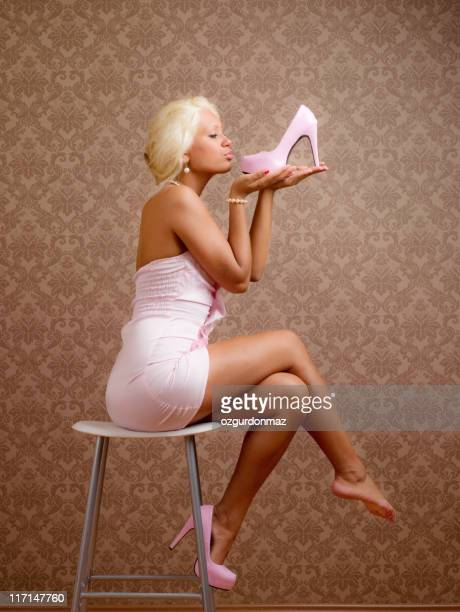 Beautiful woman kissing new shoes