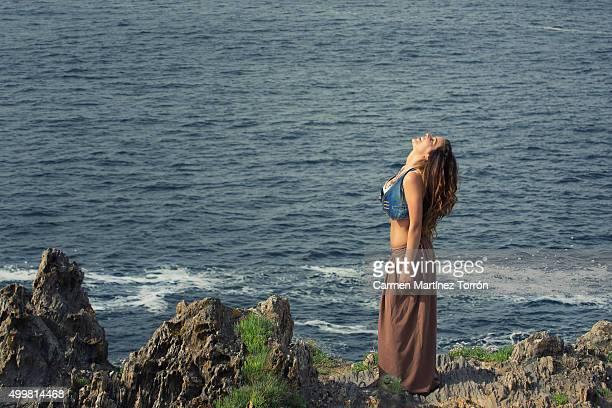 beautiful woman laughing and wearing denim vest. - carmen bella foto e immagini stock