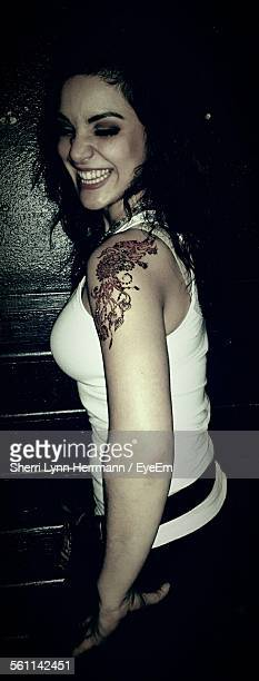 beautiful woman laughing at nightclub - lynn pleasant stock pictures, royalty-free photos & images