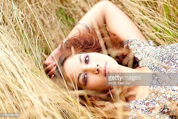 Beautiful woman laying in grass