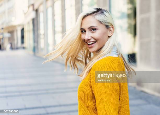 beautiful woman looking back over her shoulder - looking over shoulder stock pictures, royalty-free photos & images