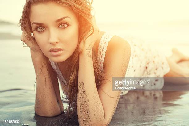 Beautiful woman lying down on a beach