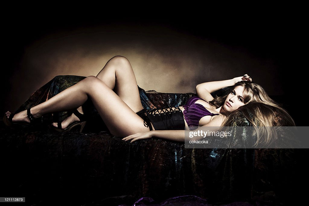 Awe Inspiring A Beautiful Woman Lying In Lingerie On A Black Couch High Uwap Interior Chair Design Uwaporg