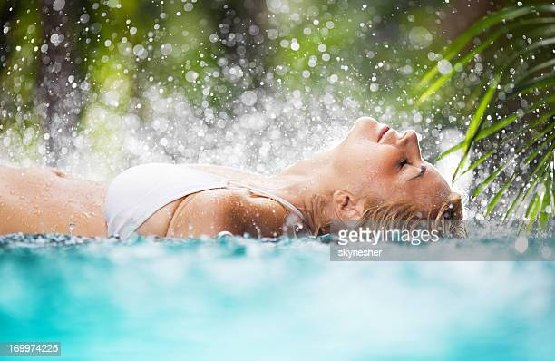 beautiful woman lying in the tropical pool. - standing water stock pictures, royalty-free photos & images