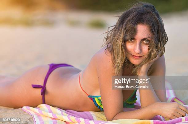 Beautiful woman lying on the beach