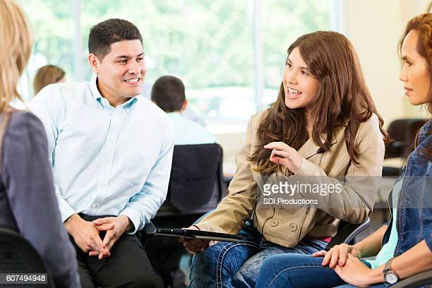 Beautiful woman makes a point during business meeting