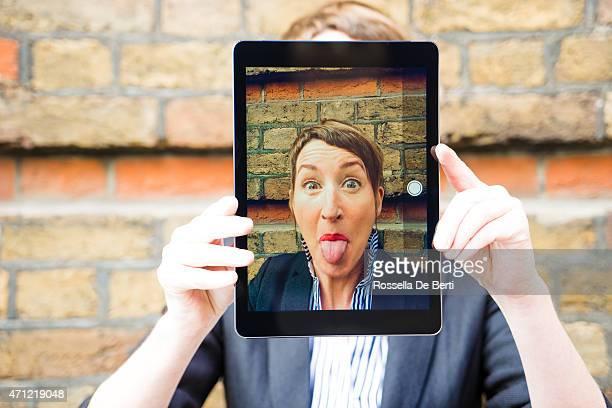 Beautiful Woman Making Jokes And Taking Selfportrait