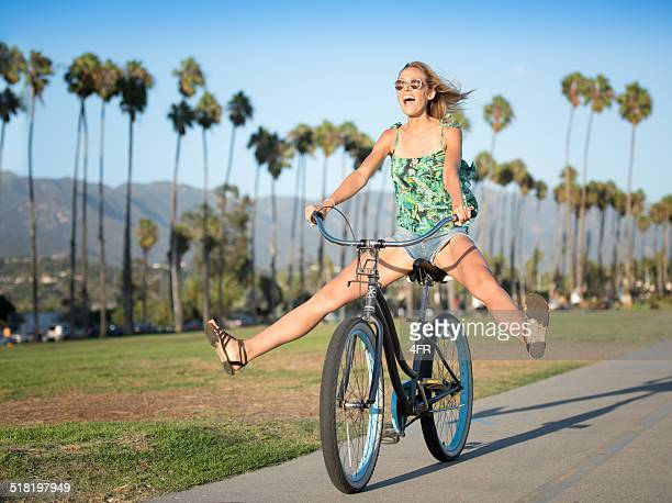 beautiful woman on a bicycle, candid fun - santa barbara stock photos and pictures