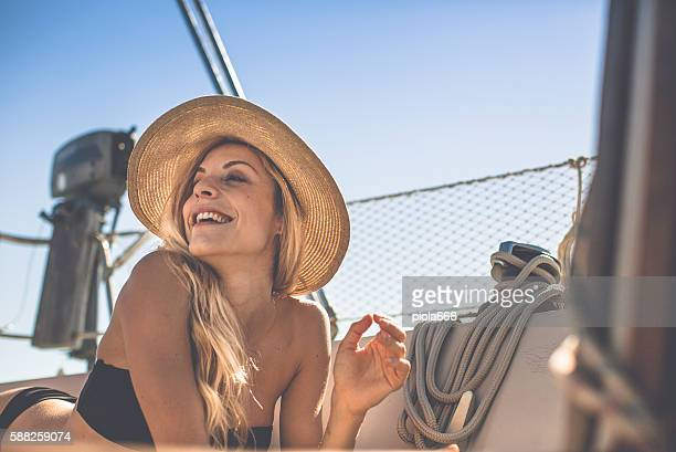 Beautiful woman on a sailing yacht