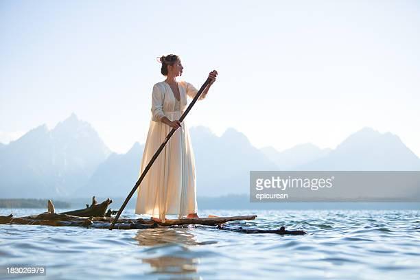 Beautiful woman on a wooden raft