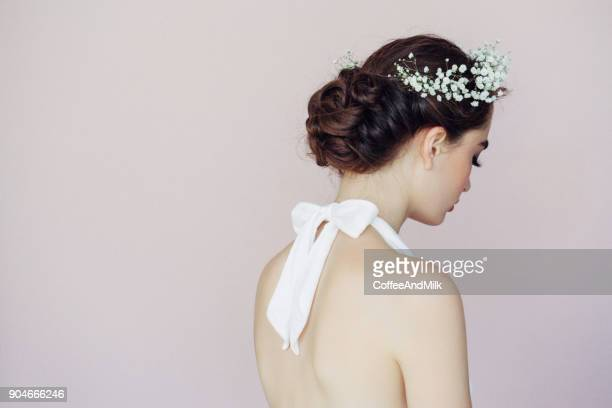 beautiful woman on light background - hairstyle stock pictures, royalty-free photos & images