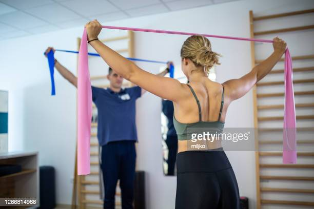 beautiful woman on physiotherapy - sports medicine stock pictures, royalty-free photos & images