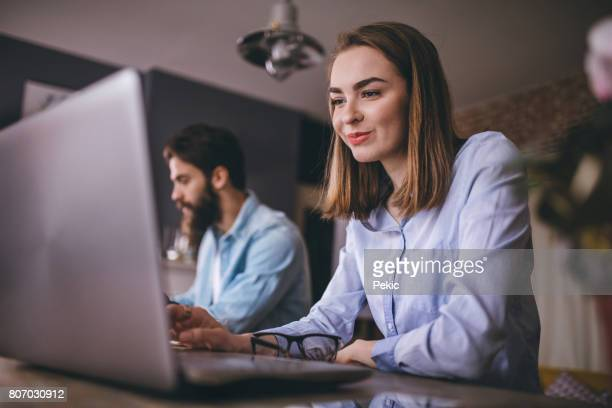 beautiful woman on work place - design occupation stock pictures, royalty-free photos & images