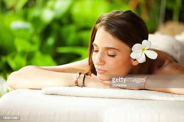 Beautiful woman outdoor on spa massage