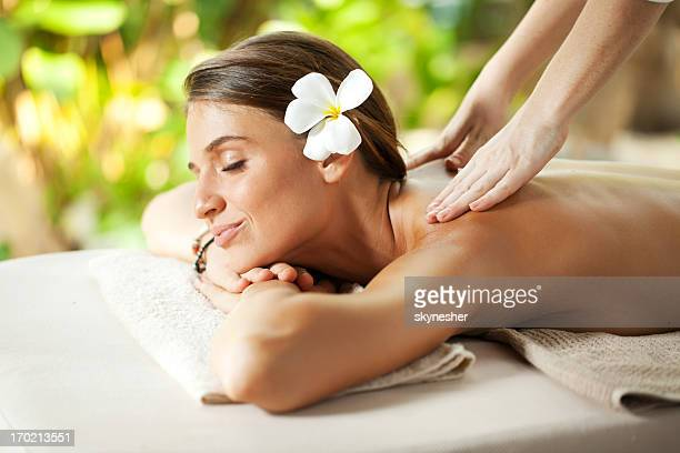Beautiful woman outdoor receiving a back massage.