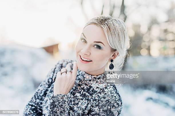 Beautiful woman outdoors in winter