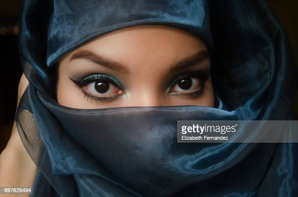 Beautiful woman peering over veil