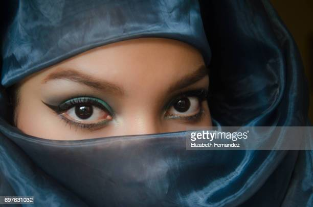 Beautiful woman peering over veil