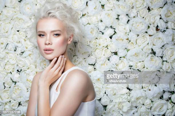 beautiful woman - floral pattern dress stock pictures, royalty-free photos & images