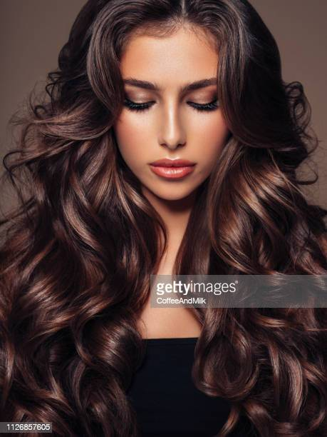 beautiful woman - wavy hair stock pictures, royalty-free photos & images