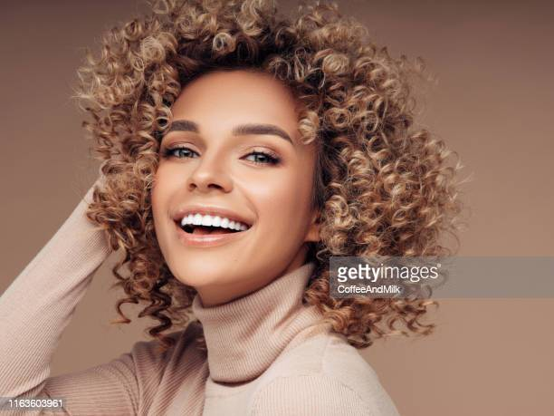 beautiful woman - curly stock pictures, royalty-free photos & images
