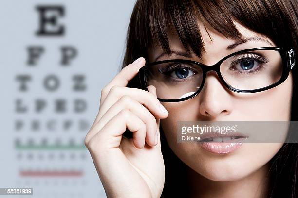 beautiful woman - eye chart stock photos and pictures